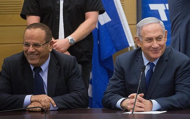 Prime Minister Benjamin Netanyahu (R) with former communications minister Ayoub Kara at a Likud faction meeting at the Knesset, on May 7, 2018. (Miriam Alster/Flash90)