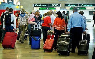 Illustrative: Travelers seen at the arrival hall of Ben Gurion International Airport, near Tel Aviv, on April 11, 2018. (Moshe Shai/FLASH90)