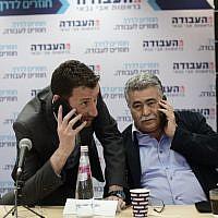 Labor MKs Itzik Shmuli (L) and Amir Peretz  at the party's headquarters in Tel Aviv on February 13, 2019. (Tomer Neuberg/Flash90)