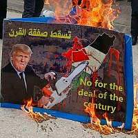 Palestinians protest against US President Donald Trump's so-called Deal of the Century, in the West Bank city of Hebron, February 22, 2019. (Wisam Hashlamoun/Flash90)