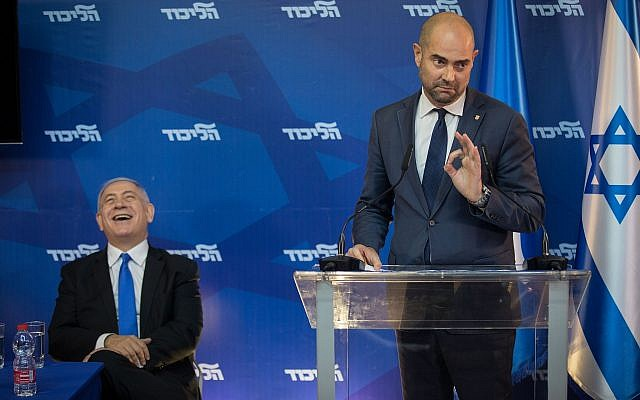 Newly appointed Justice Minister Amir Ohana entertains Prime Minister Benjamin Netanyahu at a Likud gathering. (Hadas Porush/Flash90)