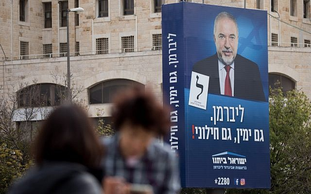 An election campaign poster showing Yisrael Beytenu head Avigdor Liberman over the caption, 'Right-wing, and secular too,' in Jerusalem on April 2, 2019, ahead of the April 9 general elections. (Yonatan Sindel/Flash90)