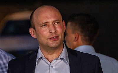 Naftali Bennett gives a statement to the media, outside his home in Ra'anana, June 2, 2019, hours after being fired as education minister. (Flash90)