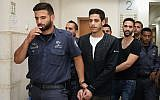 Meir Gamliel, accused of involvement in a hit-and-run road accident in which an 11-year-old boy was severely injured, seen arriving at for a hear at the Jerusalem District Court, on June 3, 2019. (Noam Revkin Fenton/Flash90)