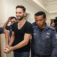 Natanel Sandrusi, accused of running over an 11-year-old child, severely wounding him, and then fleeing the scene, arrives for a hearing at the Jerusalem District Court, on June 3, 2019. (Noam Revkin Fenton/Flash90)