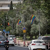 Pride rainbow flags hang on poles on Agron street in central Jerusalem on  June 4, 2019, ahead of the Jerusalem Pride Parade scheduled for June 6 that year (Hadas Parush/Flash90)