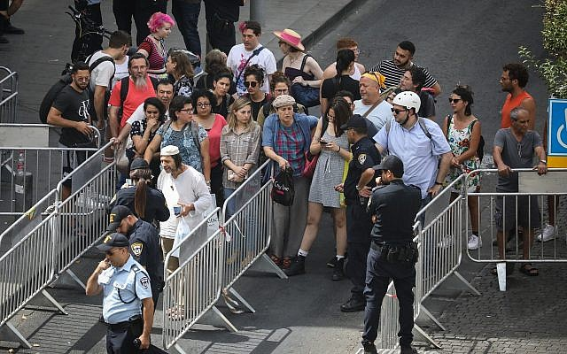 Security checks at an entrance to the Gay Pride Parade in Jerusalem, on June 6, 2019. (Noam Revkin Fenton/Flash90)