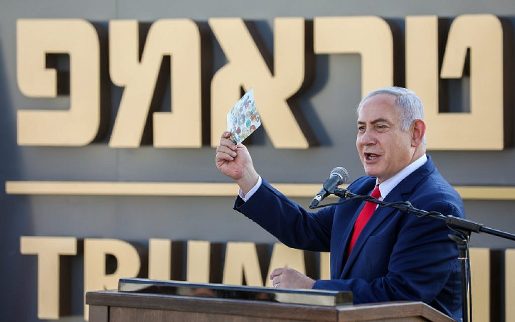 Prime Minister Benjamin Netanyahu speaks at the ceremony for a new town named for US President Donald Trump, in Kela Alon in the northwestern Golan, on June 16, 2019. (David Cohen/Flash90)