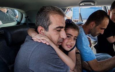 Mahmoud Qadusa (R) hugs his daughter after being released from prison on June 25, 2019. (Yonatan Sindel/Flash90)