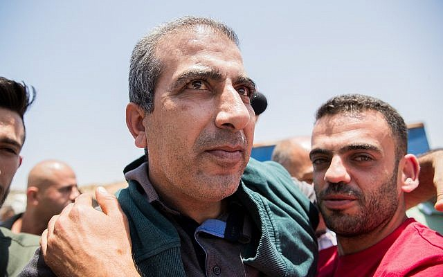 Mahmoud Qadusa, seen after his release from Israeli detention, at the Beitunia Crossing in the West Bank city of Ramallah, June 25, 2019. (Yonatan Sindel/Flash90)