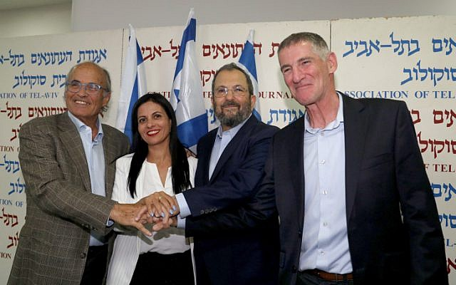 Former Prime Minister Ehud Barak (2R), Prof. Yifat Bitton (2L), retired major general Yair Golan (R) and Dr. Kobi Richter pose for a picture during a press conference announcing the establishment of a new political party led by him in Tel Aviv on June 26, 2019. (Flash90)