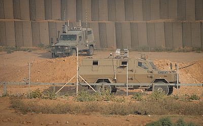 Israeli military vehicles are seen during clashes along the border fence between Israel and the Gaza Strip, near Gaza City, on June 28, 2019. (Hassan Jedi/Flash90)