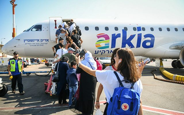 Passengers boarding what appears to be one of the final Arkia Airlines flights to Eilat at the Sde Dov Airport in Tel Aviv on June 30, 2019. (Flash90)