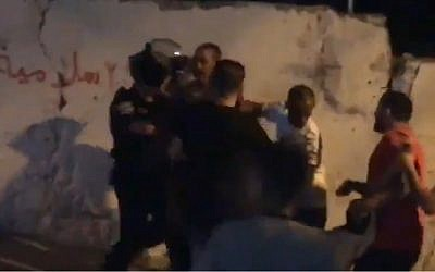 Screen capture from video allegedly showing a Palestinian man who was shot by Israeli Police after launching fireworks at them in the Issawiya neighborhood of East Jerusalem, June 27, 2019. (Twitter)