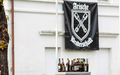 Empty beer bottles stand in front of the hotel where the Shield and Sword festival took place in Ostritz, Germany, June 22, 2019. (Daniel Schäfer/picture alliance/ Getty Images via JTA)