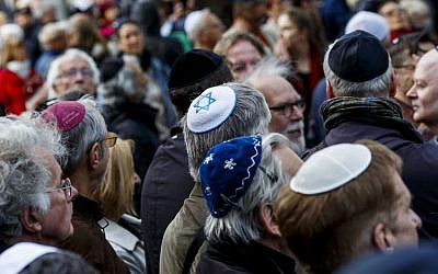 Participants wearing kippas at a rally in Berlin, April 25, 2018. (Carsten Koall/Getty Images via JTA)