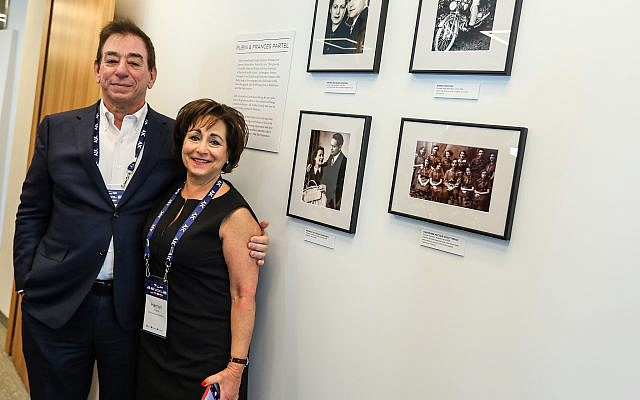 Harriet Schleifer and her husband, Leonard, at the opening of the AJC Central Europe office in Warsaw, in front a wall dedicated to her parents. (Courtesy AJC)