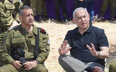 Prime Minister Benjamin Netanyahu and IDF Chief of Staff Aviv Kohavi attend a drill in northern Israel. (Amos Ben Gershom/GPO)