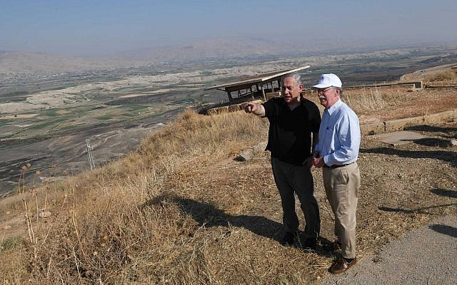 Prime Minister Benjamin Netanyahu (left) and US National Security Adviser John Bolton tour the Jordan Valley, in the West Bank, on June 23, 2019. (Kobi Gideon/GPO)