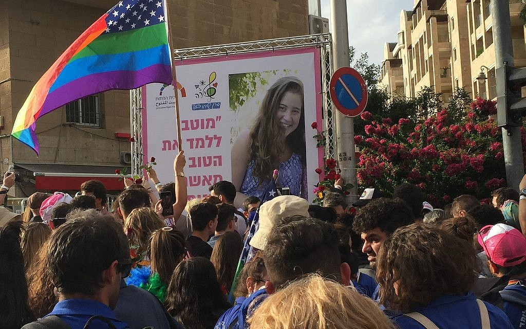 Participants in the annual Jerusalem Gay Pride parade place flowers at a memorial for Shira Banki, who was murdered during the parade in 2015, on June 6, 2019. (Times of Israel)
