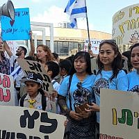 Women with the Filipino community group United Children of Israel, which helped organize the protest against deportations, in Tel Aviv on June 24, 2019. (Melanie Lidman/Times of Israel)