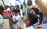 Illustrative: Two Filipino boys at the protest against deportations in Tel Aviv on June 24, 2019.  (Melanie Lidman/Times of Israel)