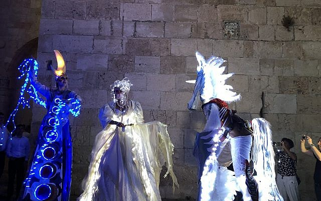 Fairytale, lit-up characters who greet visitors at Jaffa Gate, during Jerusalem's Festival of Light, which opened June 26, 2019 (Jessica Steinberg/Times of Israel)