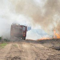 Fire teams battle a blaze caused by arson balloons launched from Gaza into Israel on June 14, 2019 (Fire Services and Rescue)