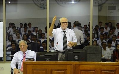 Martin Karopkin, front right, speaks at the Khmer Rouge war crimes tribunal, while American attorney Phil Weiner, left, listens. (Courtesy)