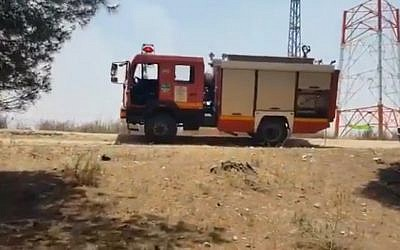 Screen capture from video of firefighters at the scene of a fire in the Kissufim Forest, June 10, 2019. (Twitter)