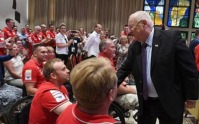 President Reuven RIvlin with participants in Veterans Games in Jerusalem, May 30, 2019 (Mark Nriman/GPO)