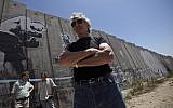 Pink Floyd co-founder Roger Waters touring Israel's security barrier in the West Bank refugee camp of Aida near Bethlehem, June 2, 2009. (Muhammed Muheisen/AP Images)