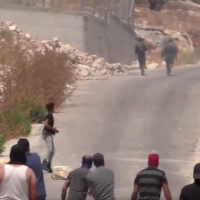 IDF soldiers flee from a group of Palestinian stone throwers on June 22, 2019. (Screen capture/Twitter)