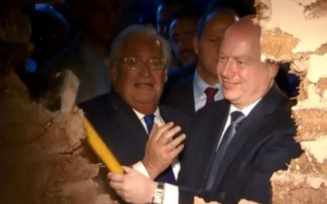 US Ambassador to Israel David Friedman (L) and White House Middle East envoy Jason Greenblatt break down a specially built wall in front of the Pilgrimage Road, at a ceremony in the East Jerusalem neighborhood of Silwan, on June 30, 2019. (Facebook/Screen capture)