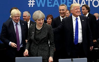 Former UK Foreign Secretary Boris Johnson, left, UK Prime Minister Theresa May, center, and US President Donald Trump at a NATO summit in Brussels, May 25, 2017. (AP Photo/Matt Dunham, Pool)