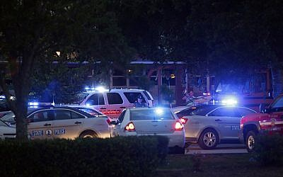 Emergency vehicles fill the parking lot at the Princess Anne Middle School in Virginia Beach, Virginia, after a nearby shooting killed 12, May 31, 2019. (AP Photo/Vicki Cronis-Nohe)