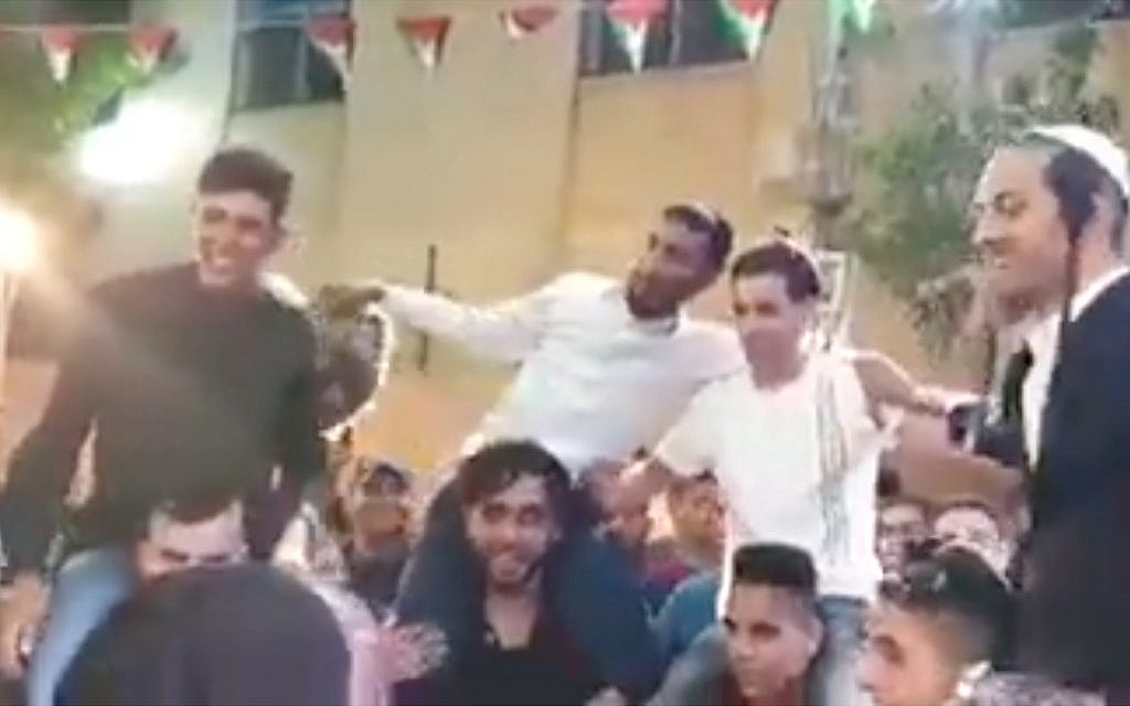 Fatah official said sacked after Jewish revelers show up at his son's wedding