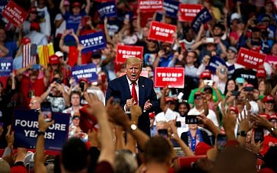 US President Donald Trump reacts to the crowd after speaking during his re-election kickoff rally at the Amway Center in Orlando, Florida, June 18, 2019. (AP Photo/Evan Vucci)