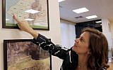 Lebanese Energy Minister Nada Boustani displays a map of offshore oil and gas blocks in the Mediterranean, on June 12, 2019 during an interview to AFP in Beirut. (Anwar Amro/AFP)