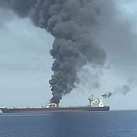 In this photo released by Iran's state-run IRIB News Agency, an oil tanker is on fire in the sea of Oman, June 13, 2019. (IRIB News Agency via AP)