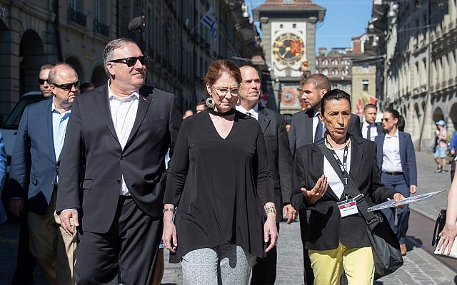 US Secretary of State Mike Pompeo, front left, and his wife Suzan, front center, listen to a tour guide during a sightseeing walk as part of Pompeo's visit in Bern, Switzerland, June 1, 2019. (Peter Klaunzer/Keystone via AP)