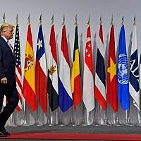 US President Donald Trump arrives to greet Japanese Prime Minister Shinzo Abe at the G-20 summit in Osaka, Japan, June 28, 2019. (AP Photo/Susan Walsh)