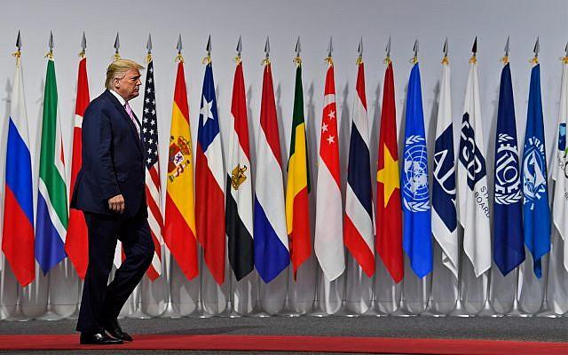 US President Donald Trump arrives to greet Japanese Prime Minister Shinzo Abe at the G-20 summit in Osaka, Japan, June 28, 2019. (AP Photo/Susan Walsh)
