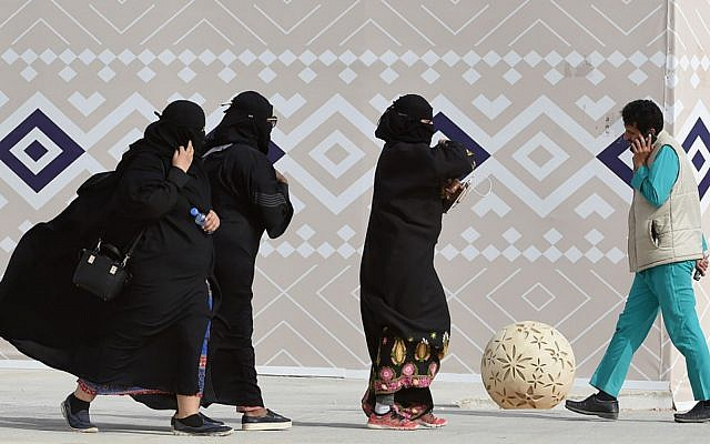 """Illustrative: Saudi women walk during the King Abdulaziz Camel Festival in Rumah, some 160 kilometers east of Riyadh, January 19, 2018. Saudi Arabia has rendered toothless the once-feared religious police amid a liberalization drive, but a planned """"public decency"""" law is stoking controversy with some fearing a revival of morality policing. (Fayez Nureldine/AFP)"""