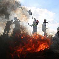Palestinians clash with Israeli forces on the Israel-Gaza border near Gaza City, June 28, 2019. (Hassan Jedi/Flash90)