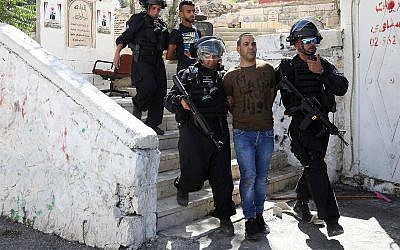 Palestinians are arrested during clashes with Israeli police in Jerusalem's neighborhood of Issawiya, June 28, 2019, a day after a Palestinian was shot and killed by police during a protest in the same neighborhood. (AP Photo/Mahmoud Illean)