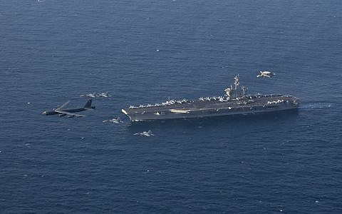 The USS Abraham Lincoln Carrier Strike Group and a US Air Force B-52H Stratofortress conduct joint exercises in the in the Arabian Sea, June 1, 2019. (US Navy photo by Mass Communication Specialist 1st Class Brian M. Wilbur/Released)