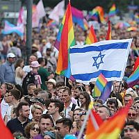 Marchers wave an Israeli flag in Warsaw's Pride Parade, June 8, 2019. (AP Photo/Czarek Sokolowski)