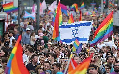 Marchers wave an Israeli flag in Warsaw's Pride Parade, June 8, 2019. (AP Photo/Czarek Sokolowski)
