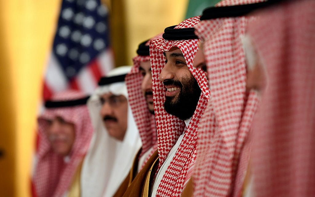 Saudi Arabia's Crown Prince Mohammed bin Salman smiles as he listens during his meeting with US President Donald Trump during a working breakfast on the sidelines of the G20 summit in Osaka, Japan, June 29, 2019. (AP Photo/Susan Walsh)